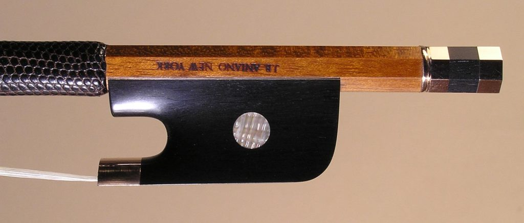 Viola Bow gold-mounted ebony frog with plain pearl eyes and divided button.