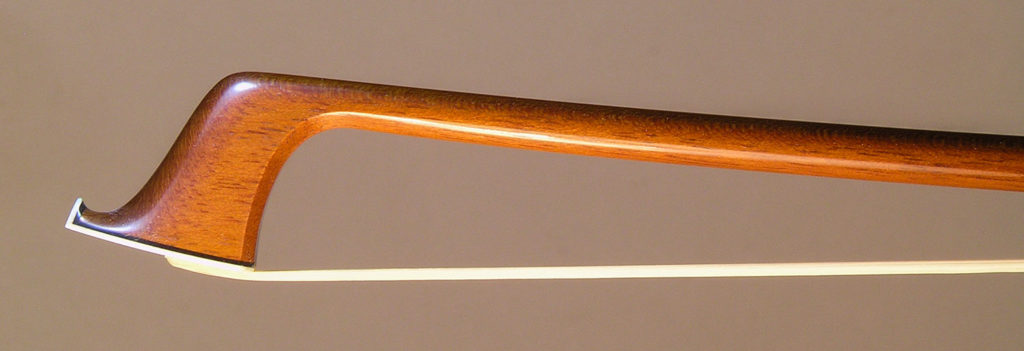 Viola Bow with a round Amourette (unfigured snakewood) stick, silver-mounted ebony frog with plain pearl eyes and divided button.