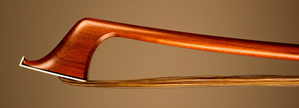 Cello Bow with a round pernambuco stick, silver-mounted Faux Tortoiseshell frog with Parisian eyes and solid button.