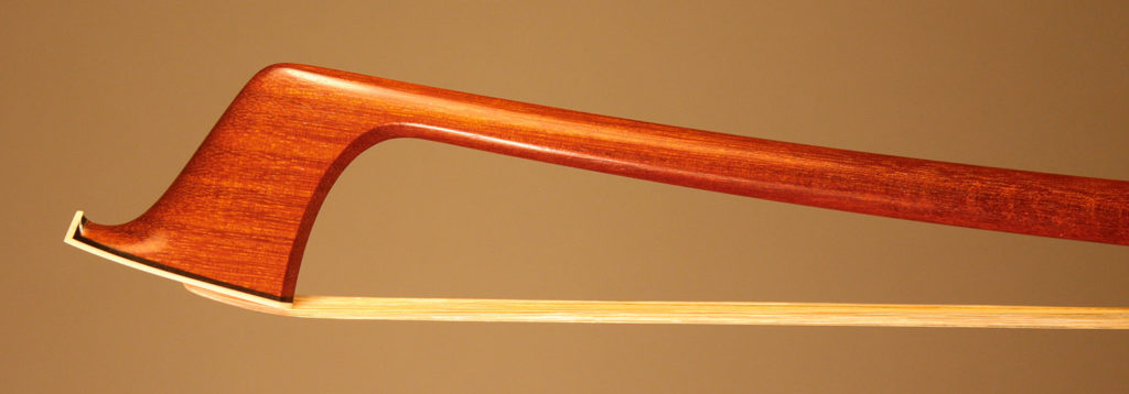 Cello Bow with a round pernambuco stick, silver-mounted ebony frog with plain pearl eyes and divided button.