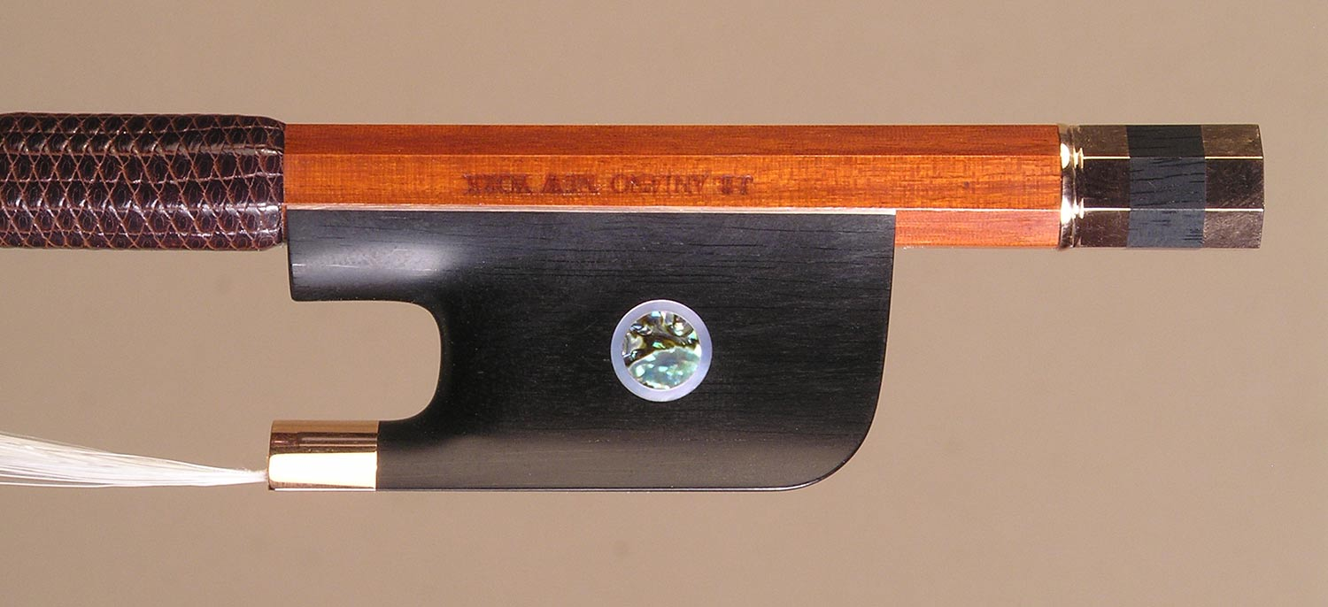 Cello Bow gold-mounted ebony frog with double pearl eyes and divided button.