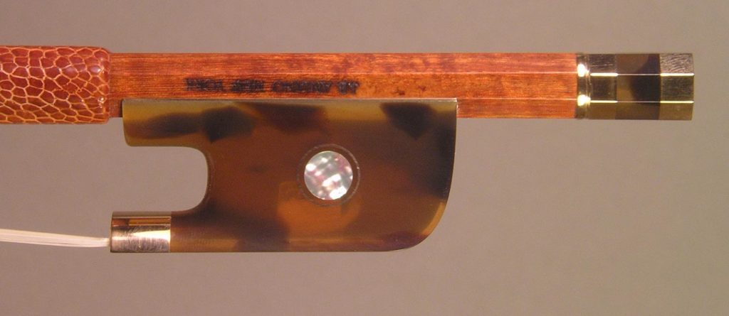 Viola Bow with a round pernambuco stick, gold-mounted Faux Tortoiseshell frog with Parisian eyes and divided button.