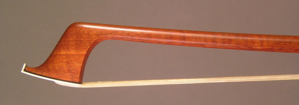 Viola Bow with a round pernambuco stick, gold-mounted Faux Tortoiseshell frog with Parisian eyes and divided button.Viola Bow gold-mounted Faux Tortoiseshell frog with Parisian eyes and divided button.