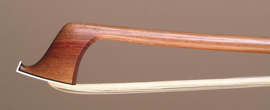 Violin Bow with a round Serebedan (Swartzia oblanceolata) stick,silver-mounted ebony frog and divided button.