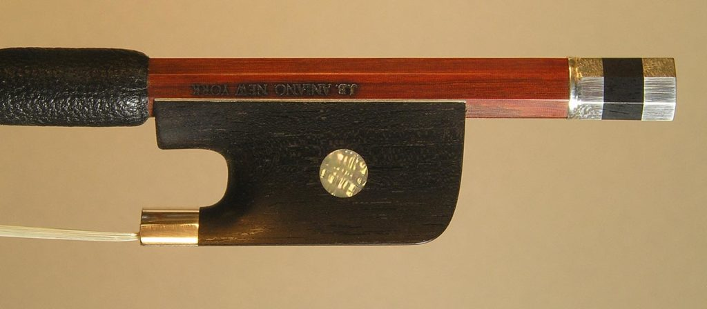 Viola Bow silver-mounted ebony frog with plain pearl eyes and divided button.