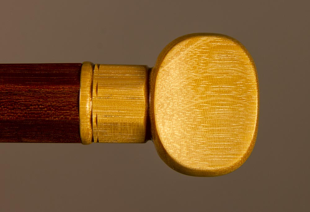 "Detail of ""banjo key"" style bass bow button of wamara."