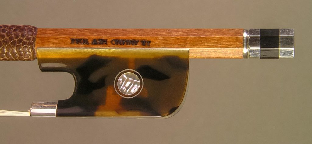 Silver-mounted violin bow with dark faux tortoiseshell frog