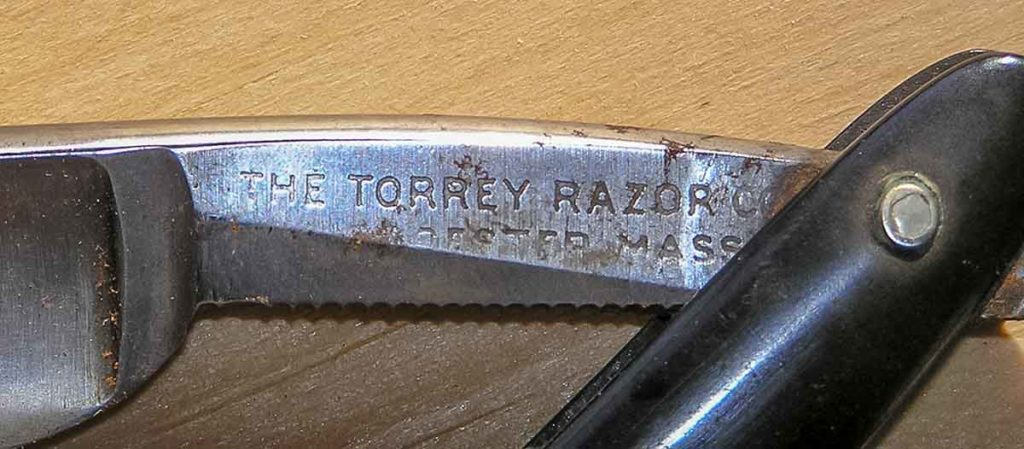 Close up of the Torrey Razor Co. straight razor's branded blade