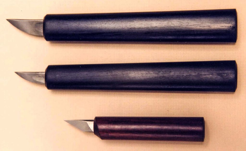Two Grandchamps-style knives and one Thomachot-style knife