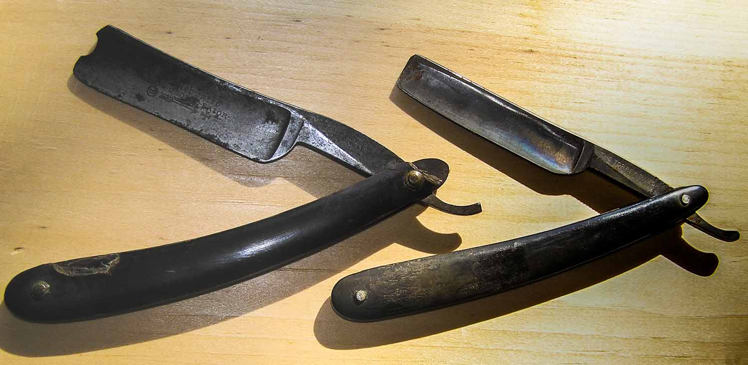 Two antique straight razors