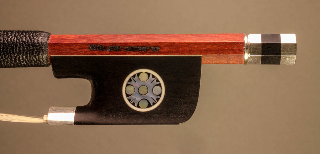 Cello Bow silver-mounted ebony frog with pearl inlay and divided button.