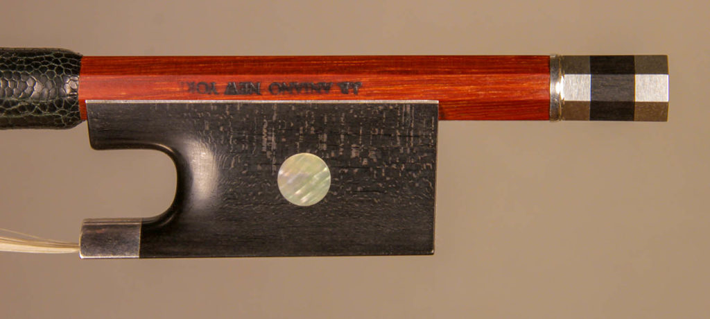 Violin Bow silver-mounted ebony frog with plain pearl eyes and divided button. Quarter sawn frog blank shows ray flecks.
